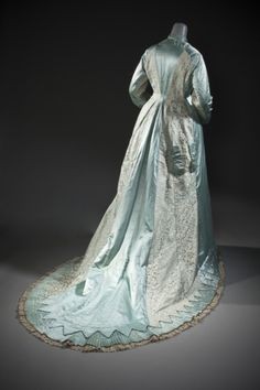 Woman's Tea Gown Miss Bishop (England (?), early 20th century) England, late 1870s Costumes; principal attire (entire body) Silk satin with supplementary weft patterning, linen machine-made lace, and silk plain weave trim| LACMA Collections