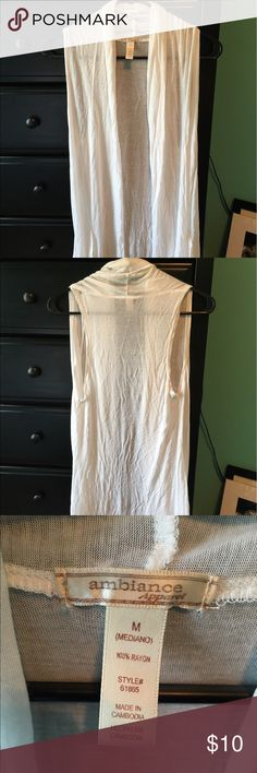 Like new sleeveless cardigan! Only warn a few times, all white, soft material Sweaters Cardigans
