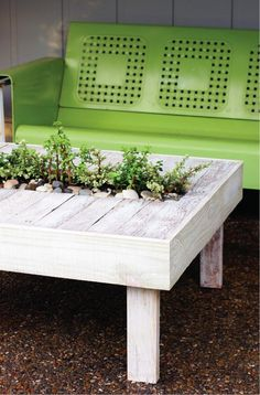Make a garden table out of an old pallet, then add plants in the middle.  Fun!