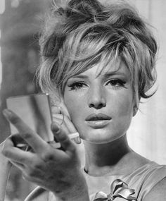 One of my very favorites, Monica Vitti. An Italian actress best known for her starring roles in films directed by Michelangelo Antonioni during the early 1960s. After working with Antonioni, Vitti changed focus and began making comedies, working with director Mario Monicelli on many films. (Wikipedia.)