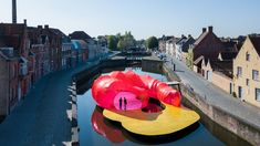 Spanish architecture duo José Selgas and Lucía Cano has erected a pink vinyl pavilion on a canal in Bruges, Belgium.