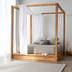"Show details for PCH Series Canopy Bed by MASHstudios this would be a great diy project to make but add a head board and some detail in the wood and a different color mea- King - 99""L x 84""W x 84""H"