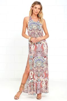 Create a work of art every time you slip on the Mosaic Masterpiece Cream Print Maxi Dress! A loose bodice hangs from tying halter straps, while two vertical straps connect to an elastic back. Cream woven viscose is home to a burgundy, sage green, purple, and orange mosaic print as it flows into a maxi skirt with a high side slit.