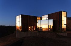 CHILE'S CONTEMPORARY CGM HOUSE IS SPLIT INTO ZONES
