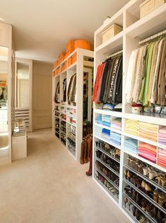 As if this closet couldn't be any better, it is organized by color! Incredible.