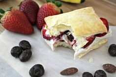 Who's ready for some Froyo? Sticking to your new year's resolution doesn't have to be hard. Cut the cravings and satisfy your sweet tooth with this peanut butter and banana frozen yogurt in a pastry puff topped with strawberries & DOVEFruit and Nut! On the blog now!  ScrappyGeek.com  #froyo #LoveDoveFruits ad #frozenyogurt #dessert #recipe #foodie #food #yum #cbias #delish #f52grams #buzzfeast #nomnom #nhblogger #huffposttaste by scrappy_geek