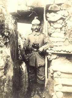 German soldier in a trench.  This is a great pic, you can really see the detail of how the trench was built.