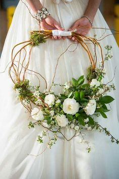 A gorgeous alternative in Bridal Bouquets, this hand made curly willow wreath is light and uncomplicated in design. Perfect for Bridesmaids in Wedding colors.