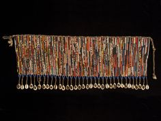 """African Tribal Art - Pikuran, beaded cache-sex, Kirdi, Cameroon. Seed beads, cotton string, cowrie shells. 20"""" (51 cm) wide by 8"""" (20 cm) high. Mid 20th century #1641    $1000"""