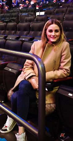 Who made  Olivia Palermo's white stripe sneakers and tan coat?