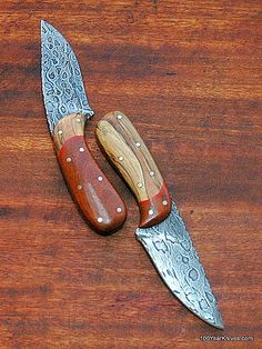 "Chain Saw Damascus Hunters by Ron Panko. Two chain saw Damascus hunting knives. One is a clip-point and the other is a slight drop-point or maybe even a roach belly. And the Ipe wood & Spalted Maple are reversed on the handles. They are each about 8 inches OAL with 3 3/4"" blades. Both come with custom leather sheaths made for them by Ron Panko. Ron forged his own Damascus steel out of chain saw chains and created Damascus blades and hunting knives that have an organic flow."