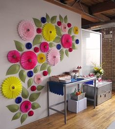 Love the big flowers on the wall as party decor!