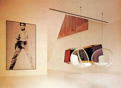 Minimalist design: Two acrylic hanging bubble chairs and a million dollar Warhol silk-screen.