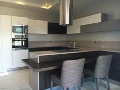 Modish Kitchen With Beautiful Countertop & Cabinets