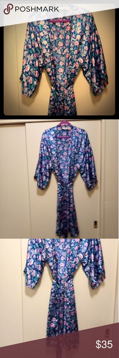 ( New item ) Victoria Secret Robe Floral print on a dark blue backgrounds flowers are pink grayish green silver White green leaves. Gorgeous robe! 💕💕 Slightly worn. In excellent condition ! I slit on each side near the leg. Tie waist feels like Silk. Hundred percent polyester. Absolutely beautiful robe!! 💕💕 Much prettier then the picture my camera is not working good. 💎💎👑👑 Victoria's Secret Intimates & Sleepwear Robes