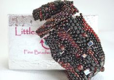 Smoldering Embers Sculptural Freeform Peyote Bracelet by littlestonedesign on Etsy.   Good use of matte black beads.