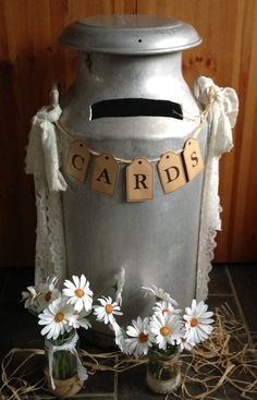Lace decorated milk churn for cards
