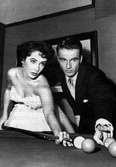 Elizabeth Taylor and Monty Clift playing pool