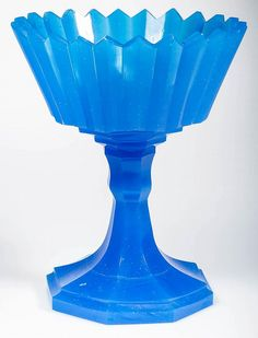 PRESSED AND POLISHED PRISM COMPOTE, translucent starch blue, truncated conical bowl with 24-point rim, raised on a hexagonal stem and single-step foot, large polished pontil mark.
