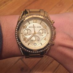 Michael Kors watch Gold tone Michael Kors watch with crystals around the face. I took 2 links out but have them for you (picture 3). Michael Kors Accessories Watches