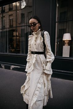 How to wear Sonia Rykiel ruffled linen dress and shearling bag with black sock boots trend in paris editorial outfit ideas