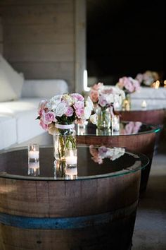 Make a coffee table by placing a glass top over half a wine barrel.