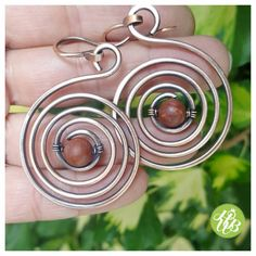 Check out this item in my Etsy shop https://www.etsy.com/listing/235899391/wire-jasper-earrings-wire-wrapped-spiral