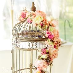 Antique Dessert Table Decor: An antique-inspired birdcage decorated the dessert table.