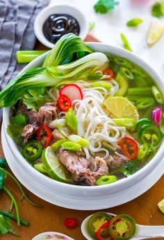 Pho, Vietnamese Noodle Soup with signature rich, meaty, and savory broth loaded with fresh toppings, bursting with flavor, and perfect for a chili night dinner. This scrumptious aromatic soup is mu...