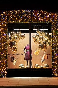 Burberry Christmas 2012. I love the twinkle lights bordering the window. So fantastic. |  tree frog creative