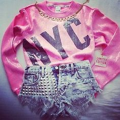 I want this outfit! NYC pink long sleeve top and studded shorts. Gold chain necklace added.