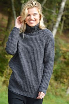 Happy Kinda Life - This roll neck jumper has head-turning style. Great relaxed fit and flattering length. Whether you're wearing it to a Christmas market or going out with friends, you'll look stylish and up to the minute. Wool blend, comes in 2 great colours.