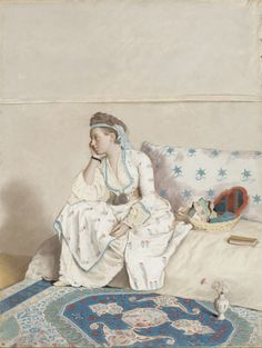 Portrait of the artist's wife, Marie Fargues, in Turkish dress (1756-1758). Jean-Étienne Liotard (Swiss-French, 1702-1789). Pastel on parchment. Rijksmuseum, Amsterdam. Fargues is shown full length, sitting on a couch. Her head is resting on her right hand. On the divan is a book with its place marked as if Fargues had been reading as well as a basket with a mirror, comb and hat. On the floor are an Oriental rug and a vase of carnations.