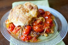Tomato Cobbler  adapted from The Bitten Word, originally from Martha Stewart Living, July 2011  serves 6-8: Roasted cherry tomatoes + caramelized onions + Gruyere biscuits