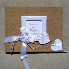 Guests could write their tidings, hopes and wishes to the couple in the matching Welcome Wish book. #myhappiness.gr #wedding #weddingfavors #bombonieres #bomboniere #wishbook.  For more information: www.myhappiness.gr