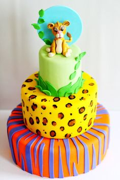 Lion and animal print cake for a girl's birthday featuring colors from the party decor. Take The Cake, Love Cake, Pretty Cakes, Cute Cakes, Deco Jungle, Lion King Cakes, Jungle Cake, Le Roi Lion, Birthday Cake Girls