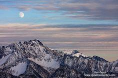 A nearly full moon over Silverstar Mountain near Washington Pass in the Mt. Baker Snoqualmie National Forest, North Cascades, Washington.
