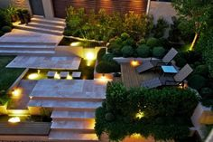 Garden - Minimalist But Elegant Concept Of Cool Backyard Designs With Concrete Steps And Pathway Surrunded By Greenery And Lighting: Awesome Backyard Designs Ideas for Relaxing Living Space Concept