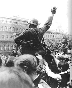 A German soldier from Army Group North is lifted aloft by a deliriously happy population of Riga on 2 July 1941, following the Latvian capital's liberation from the hated Soviet occupation. (Robert Hunt Library)