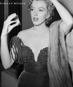 Marilyn Monroe wears Cassini (1952).