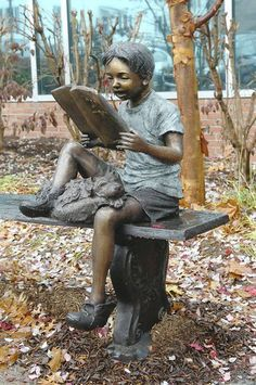 """Marley and Me"" statue from The Randolph Rose Collection - photo by Matt Button / Aegis Staff, via The Baltimore Sun; Statue of a child reading a book at the Roenna Fahrney Garden outside the Bel Air branch of the Harford County Public Library, Maryland"