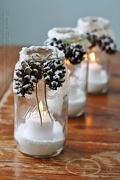 Maybe it would look better with a shorter glass. You could use battery powered candles too. Creative Pinecone Crafts for Your Holiday Decorations --> Snowy Pinecone Candle Jars Christmas Mason Jars, Noel Christmas, Rustic Christmas, Christmas Projects, Holiday Crafts, Christmas Ornaments, Handmade Christmas, Christmas 2017, Christmas Hacks