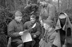 A group of soldiers from the Kalinin Front reading the report of the Soviet Information Bureau. 1942.