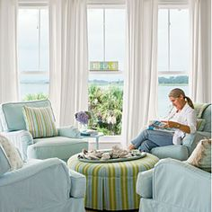 Pretty pastels in green and blue pull this serene room together. Designer Jane Coslick repeated the dining chair fabric from the adjacent room on this round ottoman to unify the two spaces.