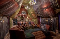 Deliciously draped room...this idea would translate nicely to a home theater room where contemporary styling doesn't suit...I've no use for such a room, but it's still my style.