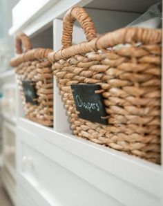 Add little chalkboards to your woven baskets for easy and stylish storage -- a great idea for a nursery. :)