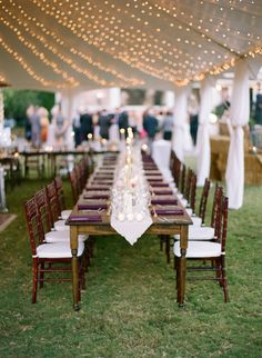 Farm Tables, Mahogany Chiavari Chairs, Father of the Bride, Tent String Lighting - all by Goodwin Events in Lake Oconee Georgia