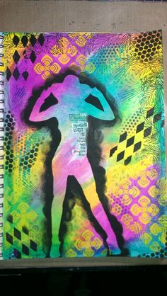 Handmade silhouette stencil, paintbrush used to apply Dylusions spray inks for bright and vibrant background.