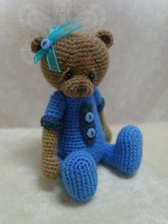 This pattern is an easy and cute design that is perfect for the beginner miniature maker. If you can do a single crochet, increase, decrease and slip stitch, you can make your very own 3 1/2 inch small Karly Bear! The directions for making Karly's incorporated outfit and her tiny outfit accent details are included.