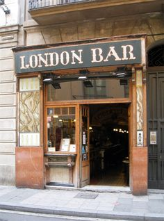 London Bar, Barcelona - a legendary bar which opened in It was frequented by notable people such as Ernest Hemingway, Pablo Picasso, Joan Miró and Salvador Dalí. As misleading as it's name is, it has a very Spanish feel to it. Enjoy your Tapas! Spain Travel, France Travel, City Magazine, Spain Holidays, Shops, Ernest Hemingway, Barcelona Spain, Wanderlust Travel, Oh The Places You'll Go